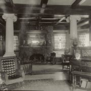 The library as seen from the living room. Note the Moss Rock fireplace designed by John Langdon. Whitman Archives photo.