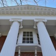 Massive Greek Ionic columns support the front portico from which an oriel window peeks out. Author photo