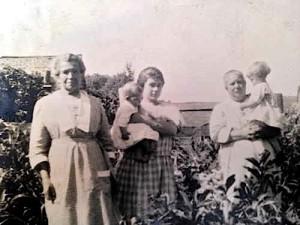 Left Kate Semler; center uniden.; right Josephine McNerney, perhaps in the garden at 528 South Park Street, n.d.