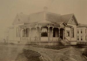 John and Sarah Boyer's house after it was moved to the corner of Cypress and Otis Streets in 1903, where it currently serves as Das Deutsche Haus for Whitman College. Whitman Archives Photos