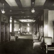 Third floor Card and Billiards Room. The grandfather clock, right, is now located in the entrance hall to the current lodge building. Whitman Archives.